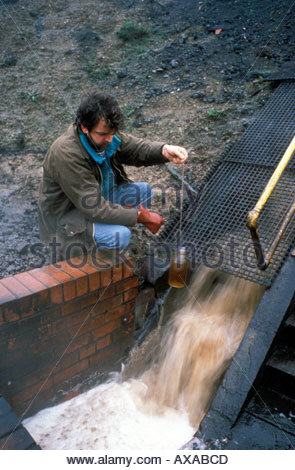 Greenpeace scientist monitoring outflow from ICI Billingham into River Tees Teesside NE England - Stock Photo