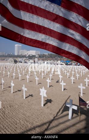Flag and crosses on the beach in Santa Monica, California. - Stock Photo