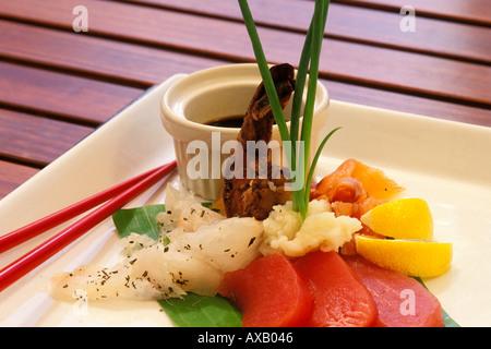 Food, Fusion of fish, tuna sashimi, snapper ceviche, grilled mahi mahi, marinated shrimp and smoked salmon - Stock Photo