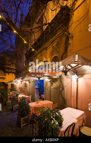 Typical restaurant at night in the Trastevere District, Rome, Italy - Stock Photo