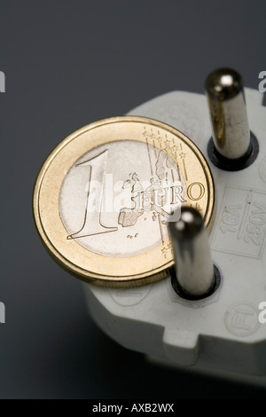 1 Euro coin and plug Symbol electricity rate energy price - Stock Photo