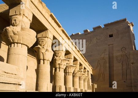 Mammisi and Second Pylon with papyriform capitals and face of Hathor with cow's ears  in the Temple of Isis Philae Temple Aswan