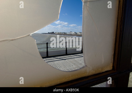 A broken window reveals a new view from Worthing pier, West Sussex, UK. Picture by Jim Holden. - Stock Photo