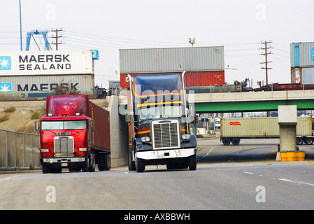 Trucks, cargo containers, ships load and unload in Los Angeles Harbor, California, USA - Stock Photo