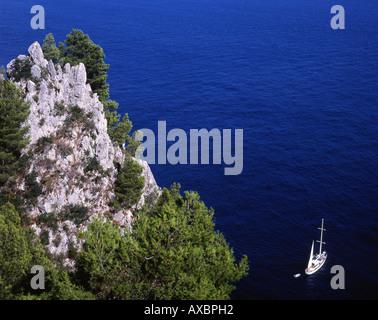View from Salto di Tiberio down to yacht in sea Capri Campania Italy - Stock Photo