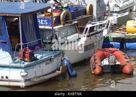 white stern leisure boat tender dinghy moored river medway maidstone kent england - Stock Photo