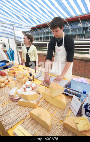 Local producer selling Teifi cheeses at a Farmers Market Cardiff South Wales UK - Stock Photo