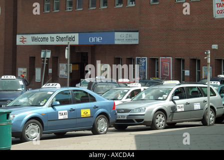 Shenfield train station forecourt parked taxis cabs waiting for customers - Stock Photo