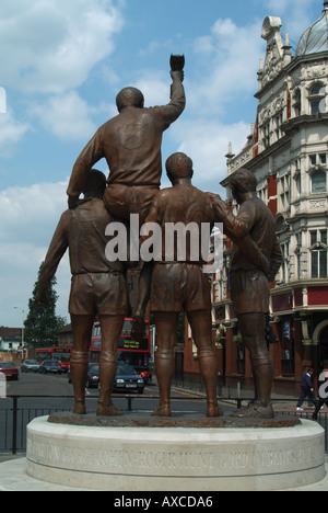 Upton Park close to West Ham United football ground statue of Bobby Moore and some of his team mates - Stock Photo