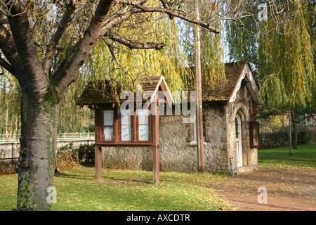 winter sunlit lock keepers hut landscaped garden river medway allington kent - Stock Photo