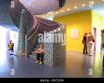 interior of Groninger Museum with students and visitors Groningen Netherlands - Stock Photo