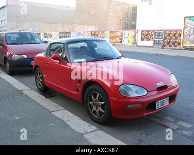 Suzuki Cappuccino parked by roadside in Berlin Germany - Stock Photo