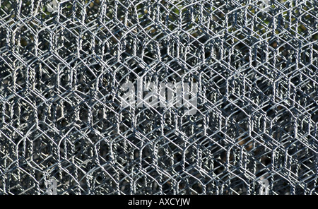 background image of rolls of metal wire mesh - Stock Photo
