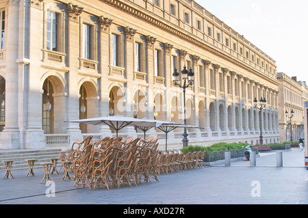 A cafe. Chairs and tables piled up for closing. Le Grand Theatre theatre on Place De La Comedie. Bordeaux, France - Stock Photo