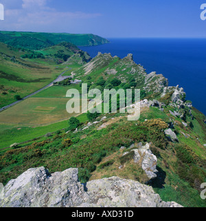 Summer view looking over rugged rocky green peaks of the Valley of Rocks and Bristol Channel North Devon England - Stock Photo