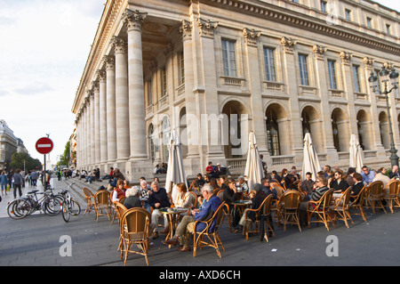 A cafe. Le Grand Theatre theatre and opera house on Place De La Comedie. Bordeaux city, Aquitaine, Gironde, France - Stock Photo