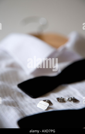 Dress shirt, bow tie, and cuff links - Stock Photo