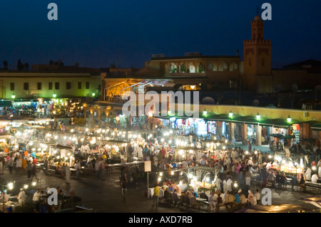 Horizontal elevated cityscape of Place Jemaa El Fna or Jemaa el-Fnaa or Jamaa al-fanâ lit up at night. - Stock Photo