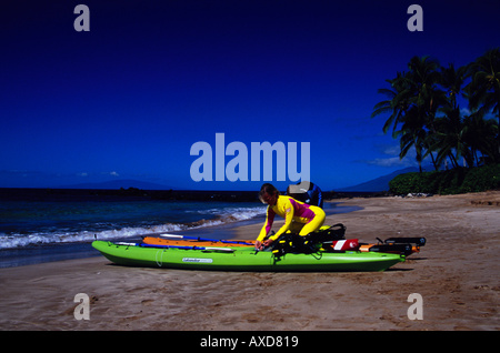 The use of kayaks for diving has become very popular in Hawaii Two divers are preparing their vessel for a dive - Stock Photo