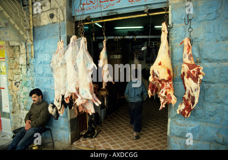 Jordan kerak village the butcher and the beef meat hanging in front of a shop - Stock Photo