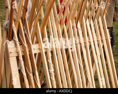 cross rack frame of wooden spears upwards many stock photo
