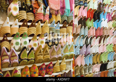 A close view of traditional 'baboosh' slippers on display at a shop in the souk area of Marrakesh. - Stock Photo