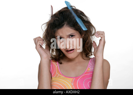 Portrait of a young woman with tangled hair - Stock Photo