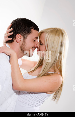 Young couple kissing, portrait - Stock Photo