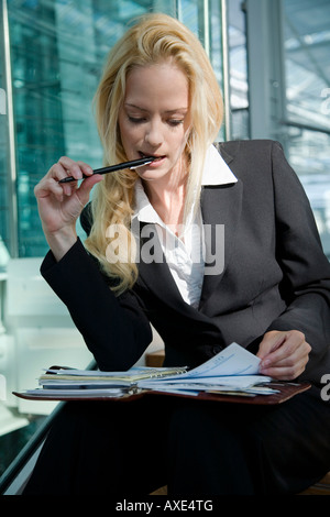 Business woman with diary, time management, portrait - Stock Photo