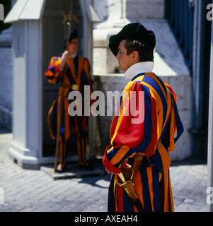 Two Swiss guards in their traditional red yellow and blue uniforms on duty at the Vatican in Rome Italy - Stock Photo