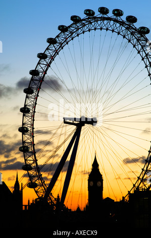 silhouette;london eye; county hall; london; england; uk; ferris wheel for tourists with spectacular views dusk - Stock Photo