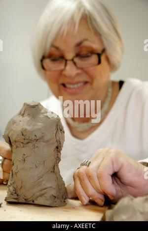 Miami Beach Florida Lincoln Road Mall ArtCenter South Florida clay sculpture class senior woman male figure - Stock Photo