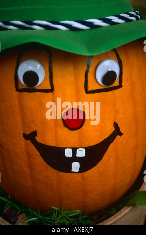 Pumpkin with Painted Face, outside the Vermont Heritage Gifts and Craft Shop, Stowe, Vermont, New England, USA - Stock Photo