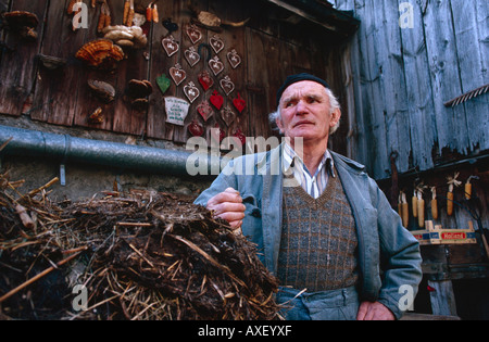 Traditional farmer Peter Eberle in the courtyard of his smallholding in Balzers, Principality of Liechtenstein - Stock Photo