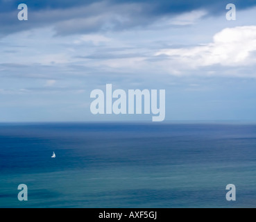 yacht in a calm sea in artistic style, mid-Wales, Aberystwyth - Stock Photo