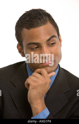 Thoughtful young man wearing a business suit - Stock Photo