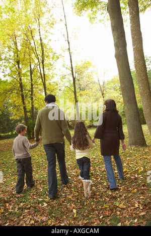Family Walking in Autumn - Stock Photo