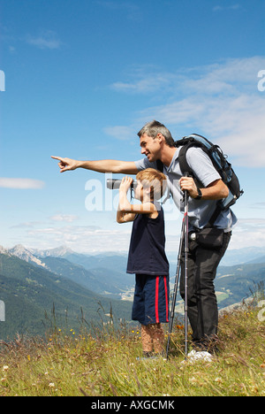 Father and Son Looking through Binoculars - Stock Photo