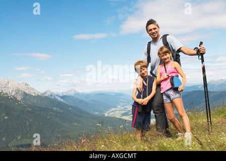 Man Hiking with Children - Stock Photo