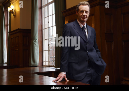 Businessman in Large Boardroom - Stock Photo