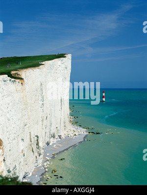 The white chalk cliffs of Beachy Head part of the Seven Sisters coastline and Beachy Head Lighthouse, near Eastbourne, - Stock Photo