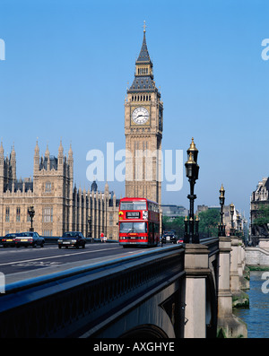 Red double decker bus crossing Westminster Bridge in front of Big Ben and the Houses of Parliament, London, England, - Stock Photo