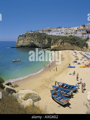 Portugal the Algarve Praia do Carvoeiro beach and village with fishing boats on the beach - Stock Photo