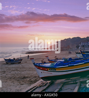 Portugal the Algarve Olhos de Agua sunset over fishing boats - Stock Photo