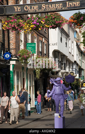 Stonegate busy narrow pedestrianised preserved old medieval street in city centre York Yorkshire England UK - Stock Photo