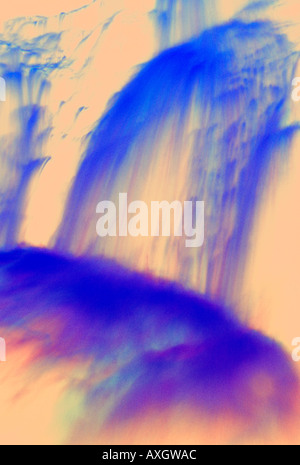 abstract multicolored impressionistic waterfall manipulated color multiple exposure slow shutter speed motion - Stock Photo