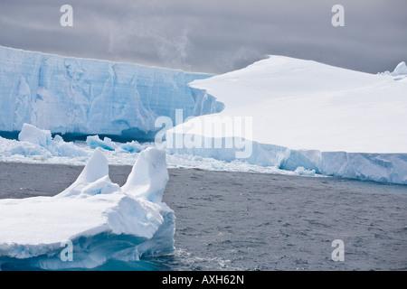 Huge tabular icebergs floating in Antarctic sea - Stock Photo