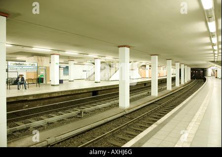 U -Bahn in Berlin Germany Europe subway train station transportation underground platform railway column - Stock Photo