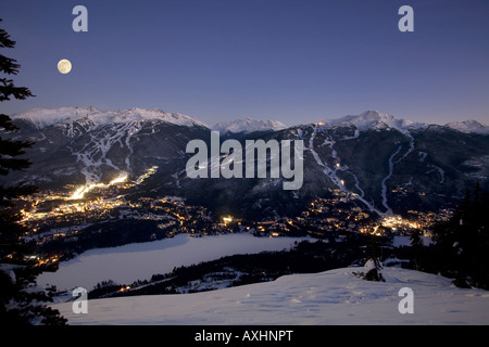 Whistler Village at dusk with Blackcomb and Whislter mountain beyond British Columbia Canada - Stock Photo