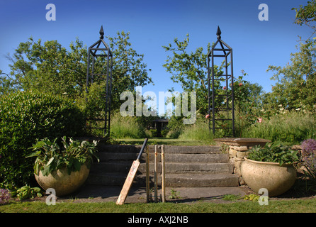 A SET OF STUMPS AND CRICKET BAT IN THE GARDEN AT MANOR FARM SOMERSET BY GARDEN DESIGNER SIMON JOHNSON UK - Stock Photo